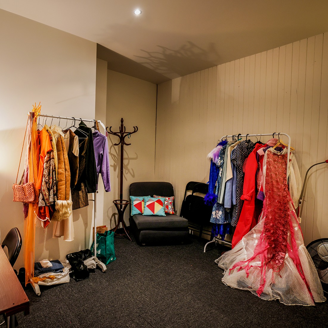 Dressing room filled with costumes on hangers