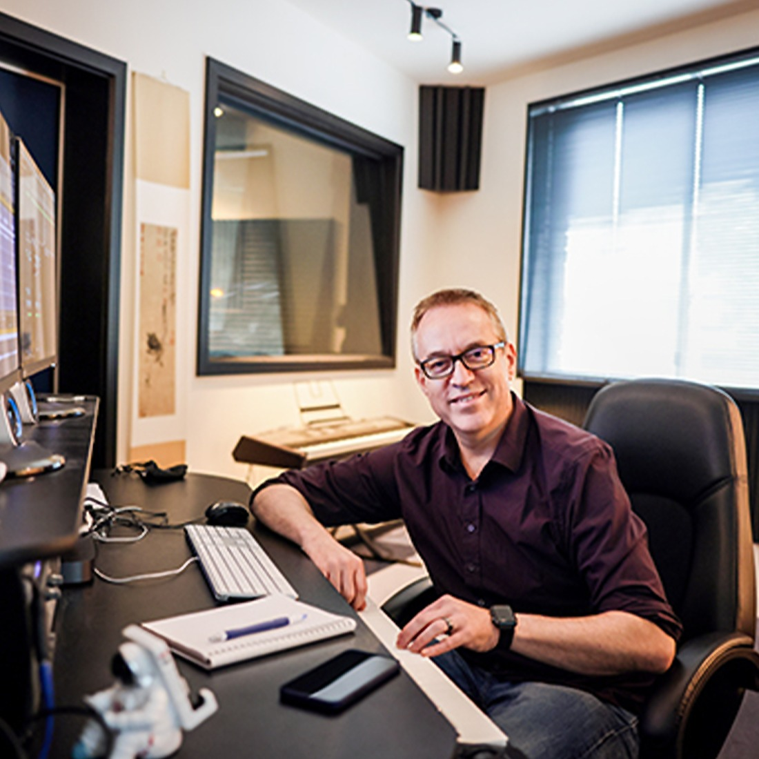 Craig sitting at his desk in his office