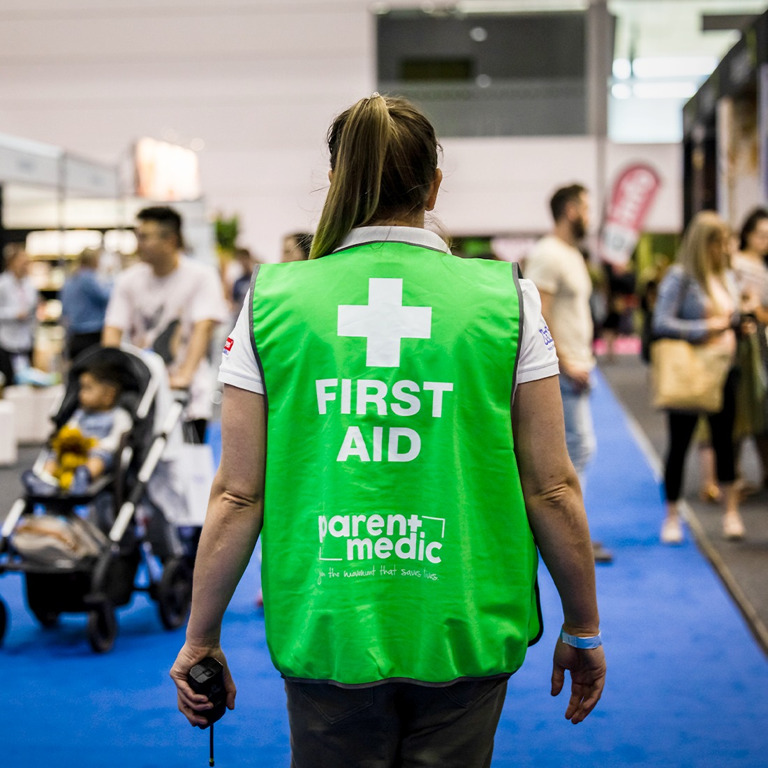Woman in a green first aid jacket