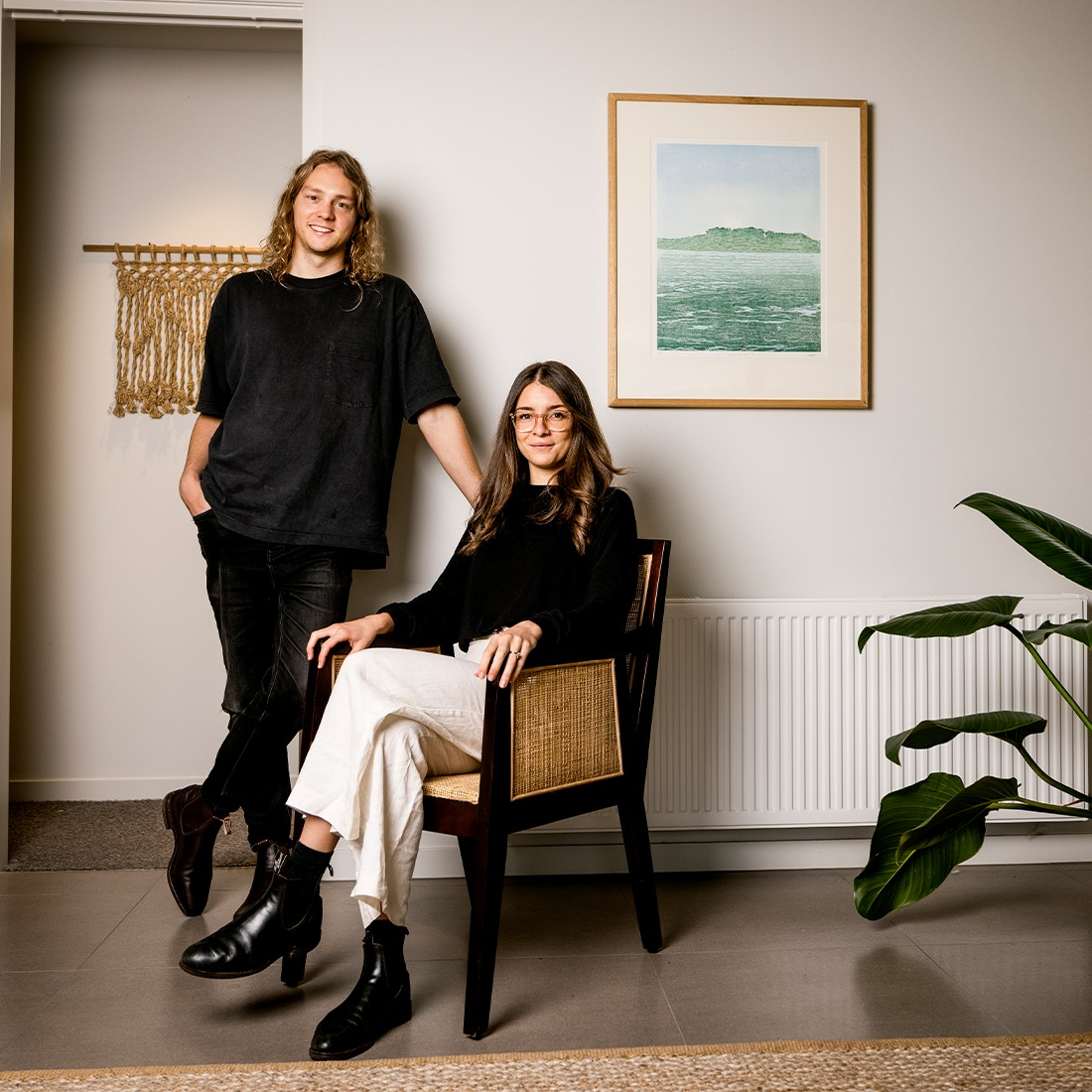 Phoebe Simpson sitting on a chair and Tom Simpson standing next to her - the owners of Hosea